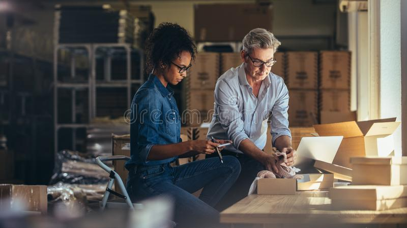 Business partners preparing shipment to deliver to customer royalty free stock photography