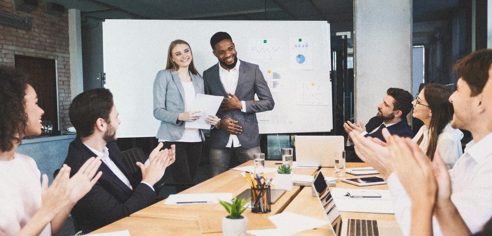 Business partners prising co-workers for presentation. Business team clapping for good presentation in office royalty free stock image