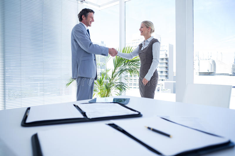 Business partners shaking hand together royalty free stock photography