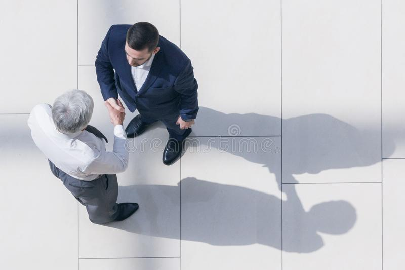 Business partners shaking hands stock photography