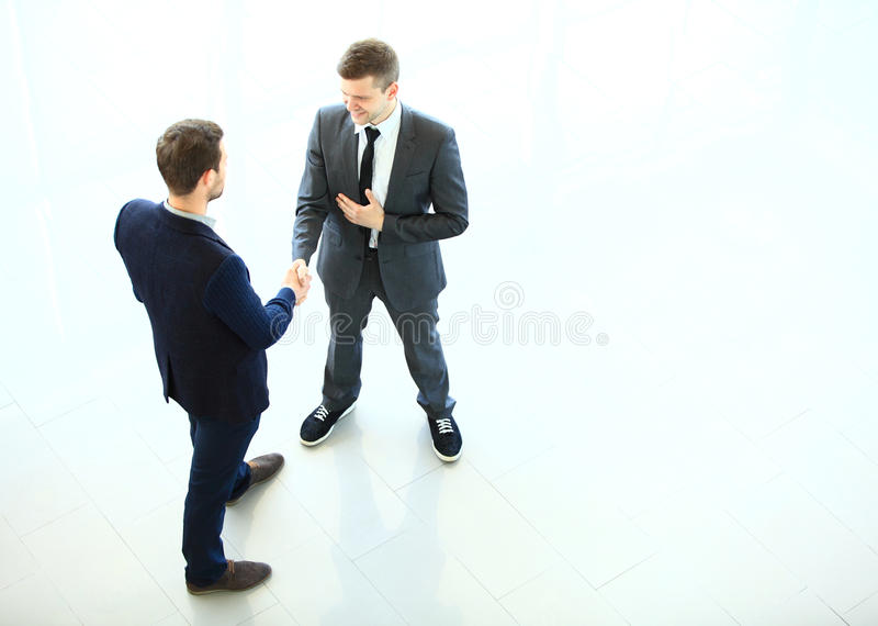 Business partners shaking hands as a symbol of unity stock photography