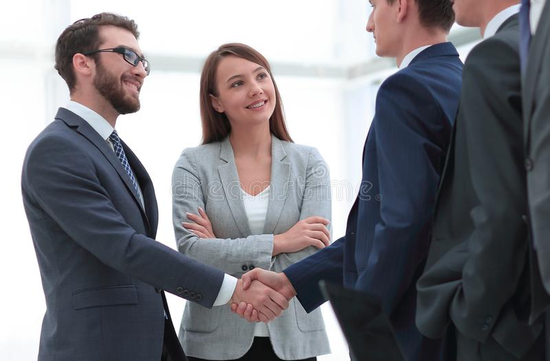 Business partners shaking hands royalty free stock photography