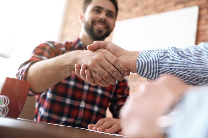 Business partners shaking hands after meeting. Closeup royalty free stock photos