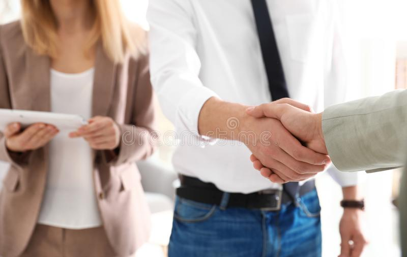 Business partners shaking hands after meeting, closeup royalty free stock photo