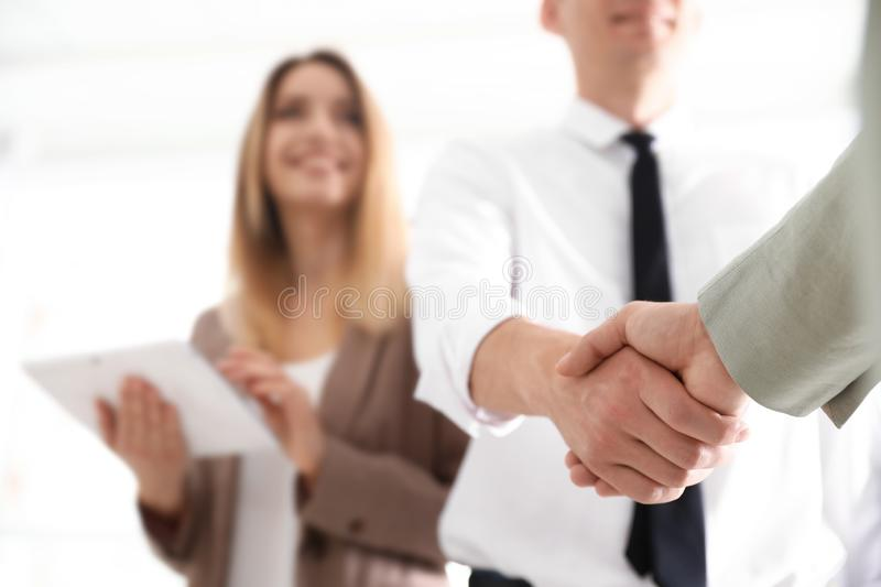 Business partners shaking hands after meeting, closeup. Space for text royalty free stock image