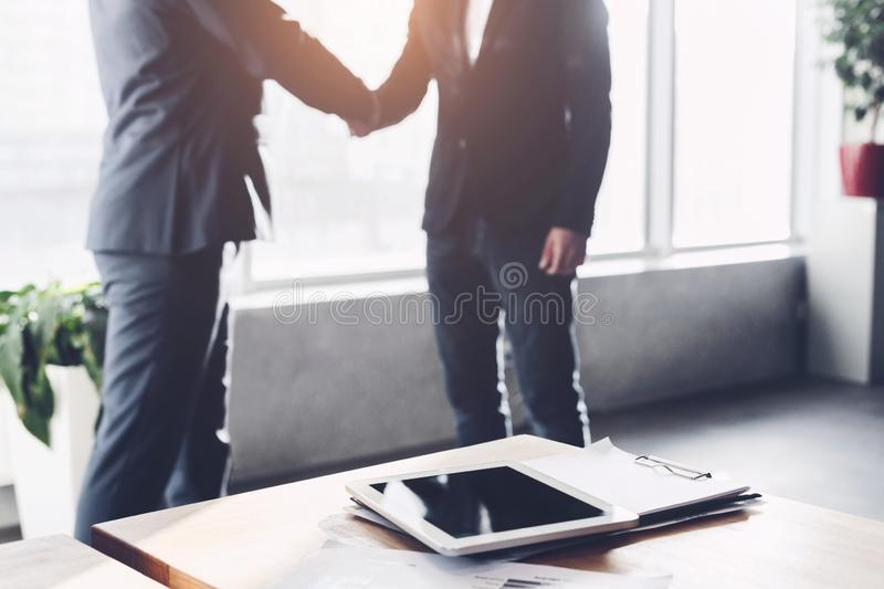 Business partners shaking hands after signing deal royalty free stock photo