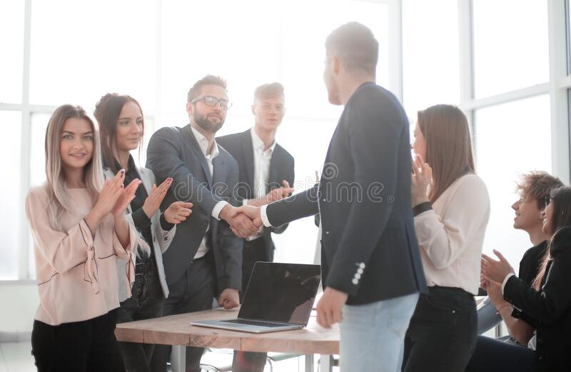 Business partners shaking hands standing in the office. royalty free stock image