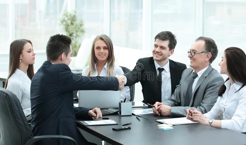 Business partners shaking hands after a successful transaction stock images