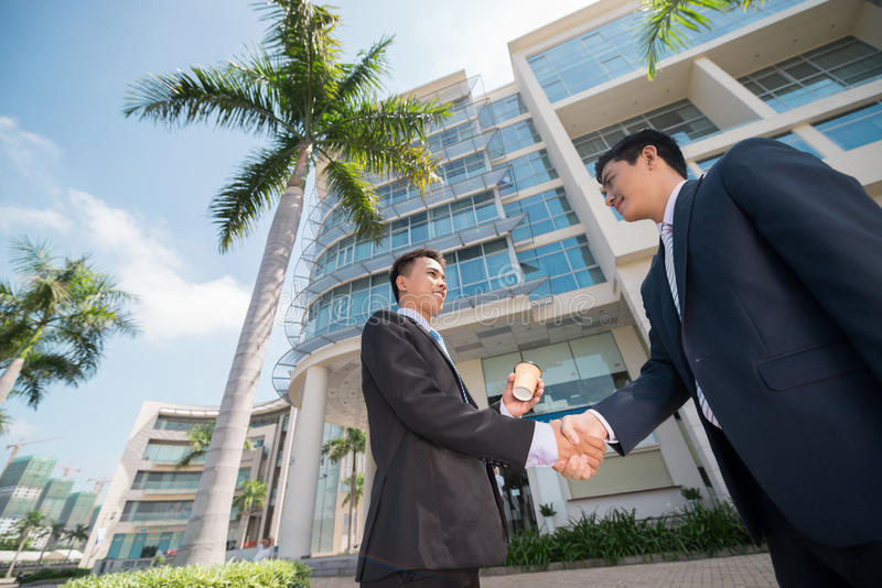Business partners. Shaking their hands outdoors stock photos