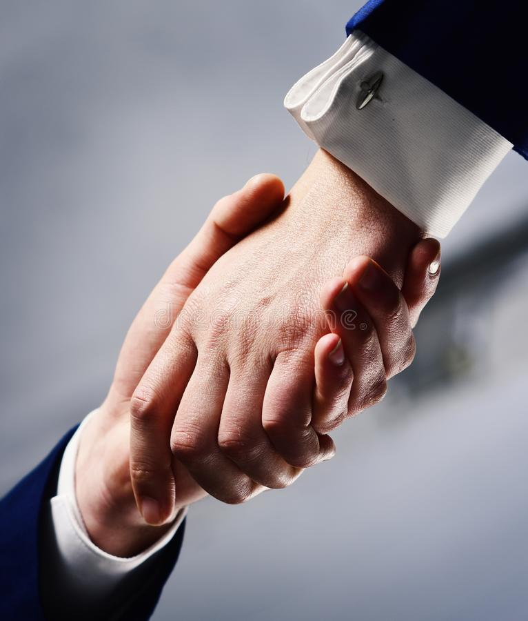 Business partners after signing agreement. Partnership, friendship and financial support. stock photography
