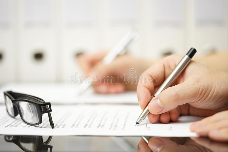 Business partners are signing contract after successful meeting stock images
