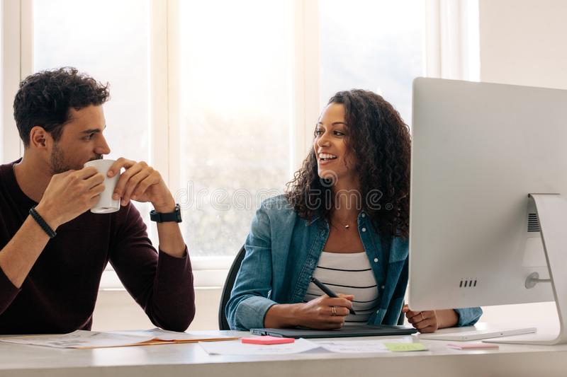 Business partners sitting together and working in office stock photos