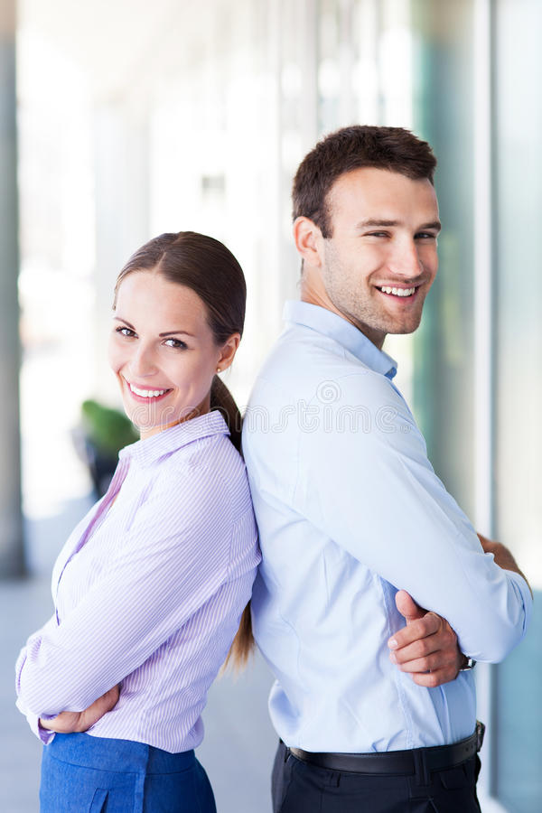 Business partners. Standing back to back royalty free stock photos