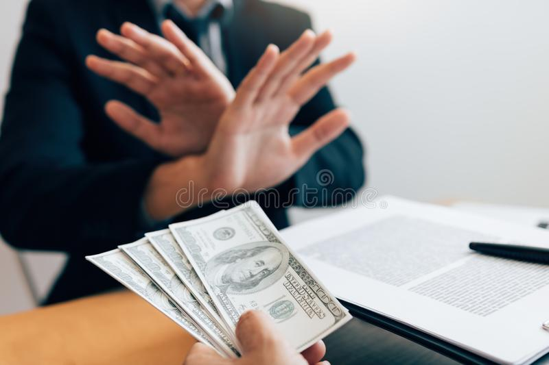 Business partners submit fraudulent cash to entrepreneurs whose male businessmen refuse to accept bribes in the office.  royalty free stock images