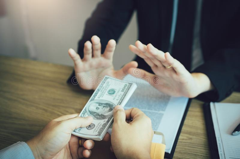 Business partners submit fraudulent cash to entrepreneurs whose male businessmen refuse to accept bribes in the office.  stock images