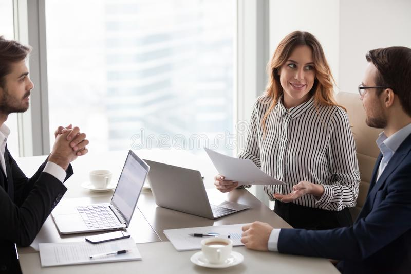 Business partners talk considering contract terms at briefing. Millennial company workers talk discussing projects at office meeting, business partners negotiate stock image