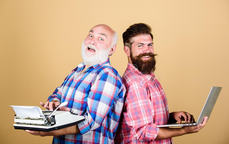 Business partners. technology battle. Modern life. youth vs old age. business approach. father and son. two bearded men. Vintage typewriter. retro typewriter stock photography