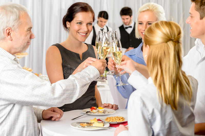 Business partners toast champagne company event stock images