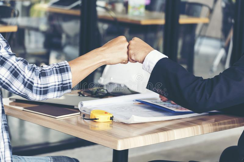 Business Partners Trust in Team Giving Fist Bump to Greeting Start up project Contractor.Businessman Teamwork are Partnership in royalty free stock photo