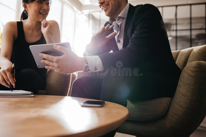 Business partners using digital tablet stock photo