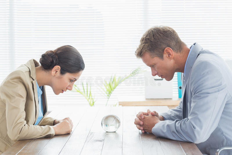 Business partners watching crystal ball stock photography