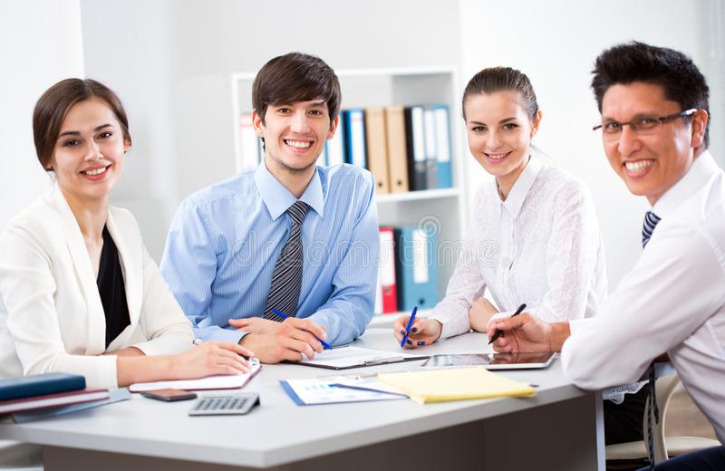 Business partners working at modern office stock photos
