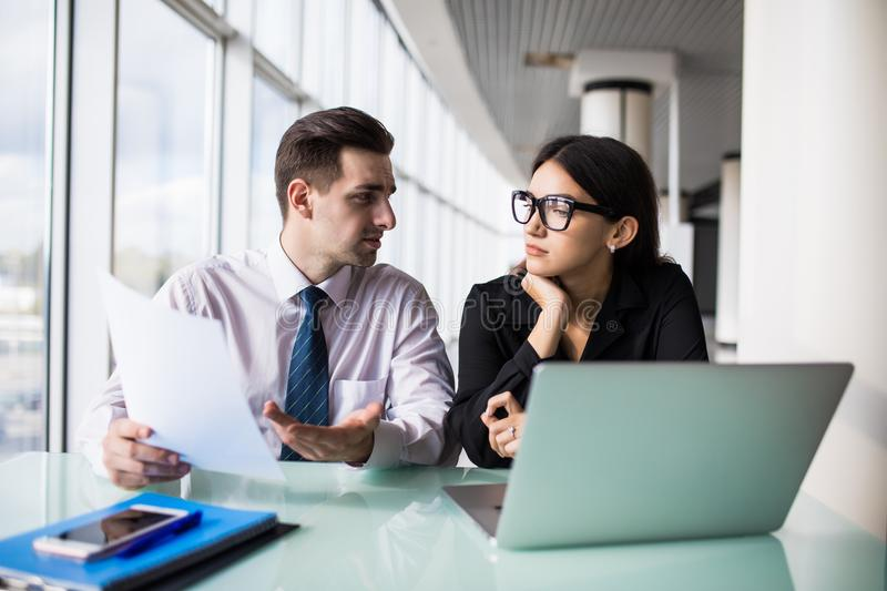 Business partners working on new project at laptop in modern office stock photo