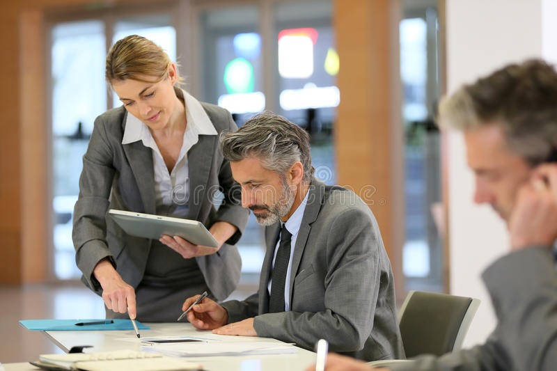 Business partners working together in office stock photography