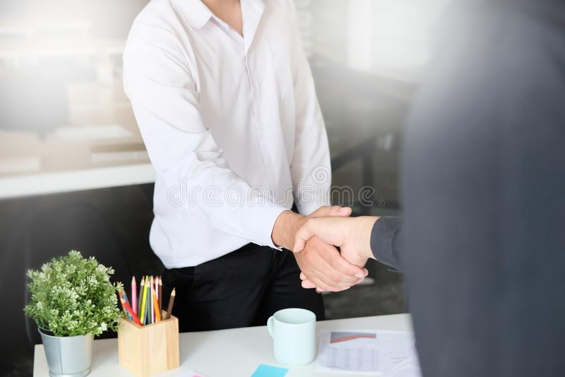 Business Partnership concept. businessman shaking hands finishing up a meeting,acquisition concept. stock photo