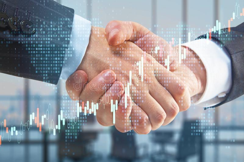 Business partnership with double exposure of handshaking men and abstract financial graphs royalty free stock photo