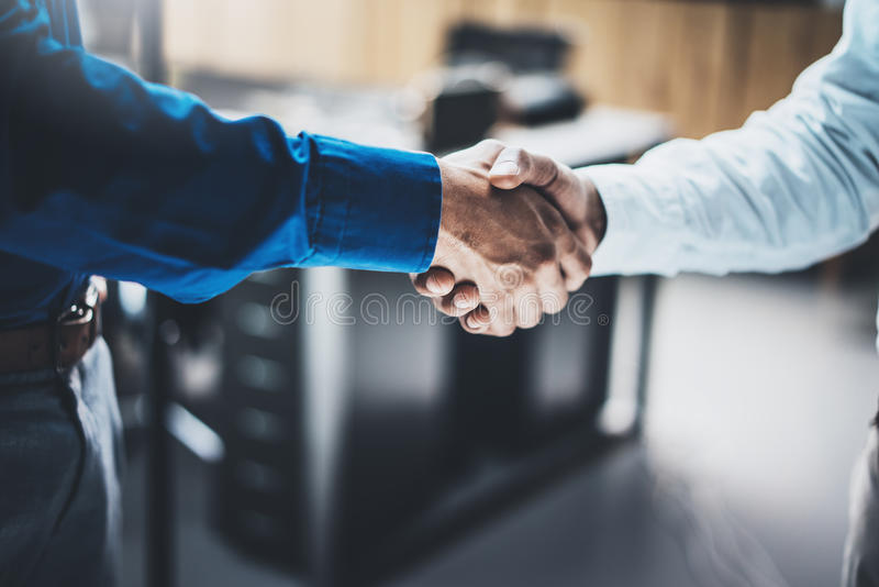 Business partnership handshake concept.Closeup photo of two businessmans handshaking process.Successful deal after great. Meeting.Horizontal, blurred background royalty free stock photography