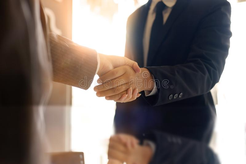 Business partnership handshake concept.Photo two coworkers hands royalty free stock images