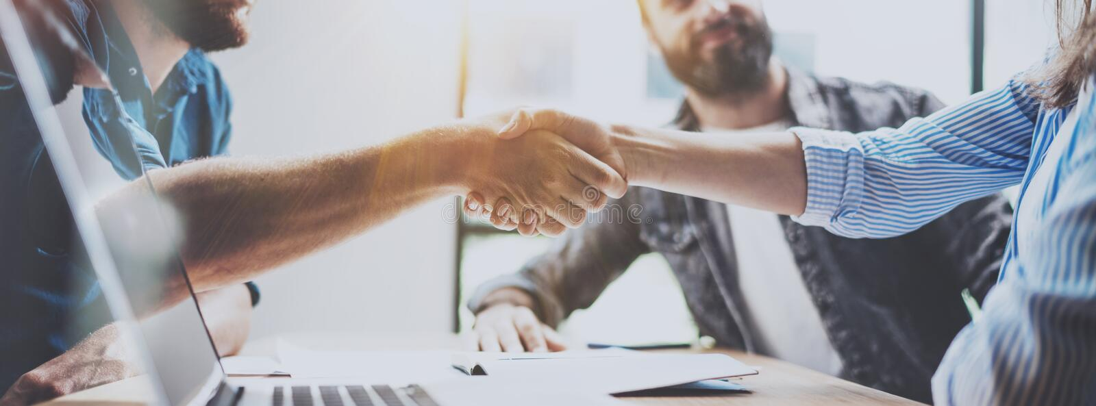 Business partnership handshake concept. Photo two coworkers handshaking process. Successful deal after great meeting stock images