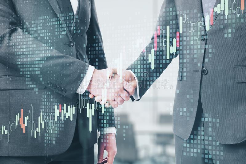 Business partnership with handshaking men stock images