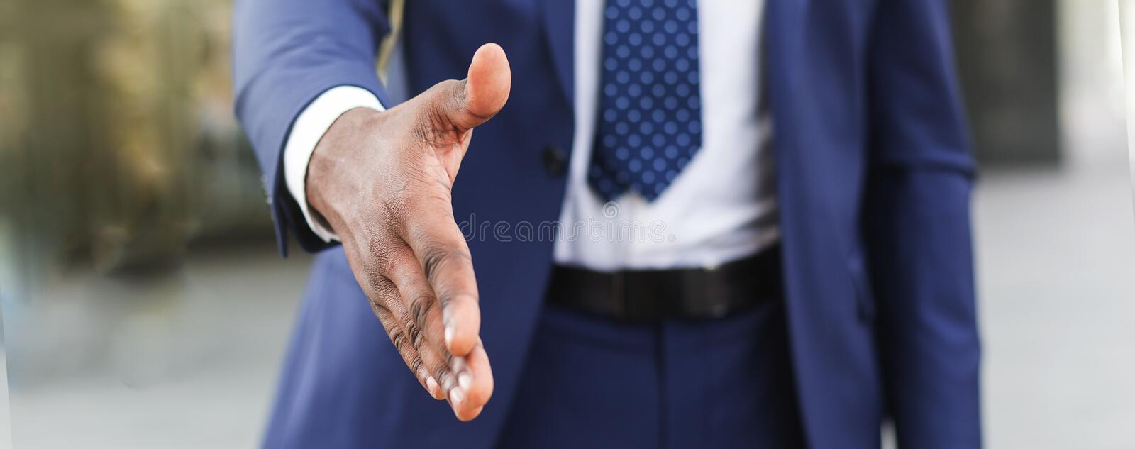 Business partnership meeting concept. Businesman extending hand for greeting royalty free stock image