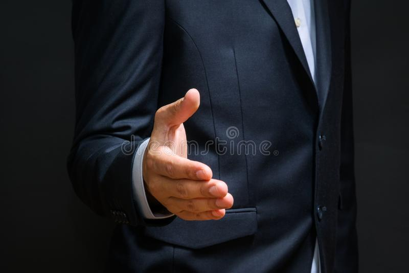 Business partnership meeting concept. Businessman handshake. Successful businessmen handshaking after good deal. Horizontal, blur. Red background royalty free stock photos