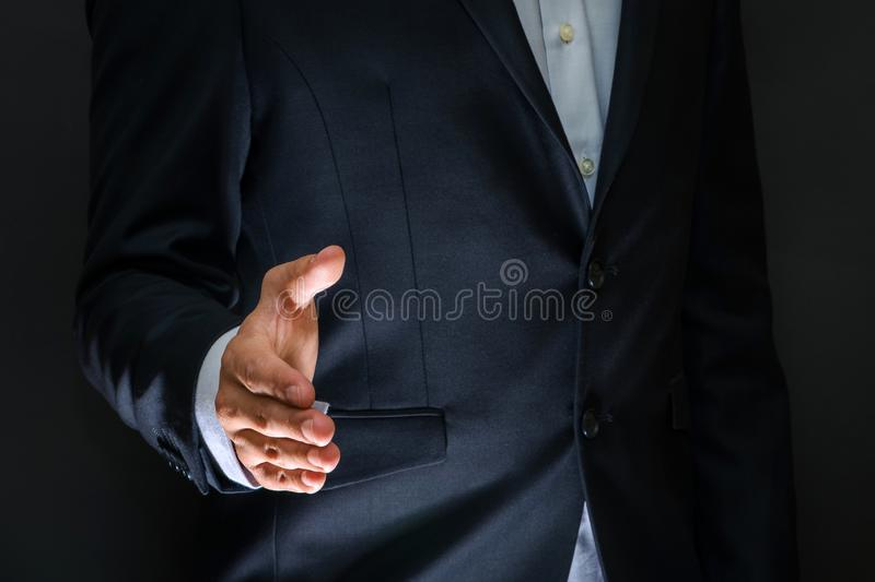 Business partnership meeting concept. Businessman handshake. Successful businessmen handshaking after good deal. Horizontal, blur. Red background stock images
