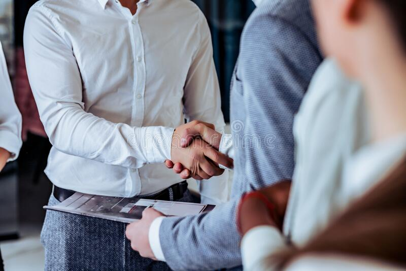 Business partnership meeting concept.Cropped image of successful businessmen handshaking after good deal royalty free stock photos
