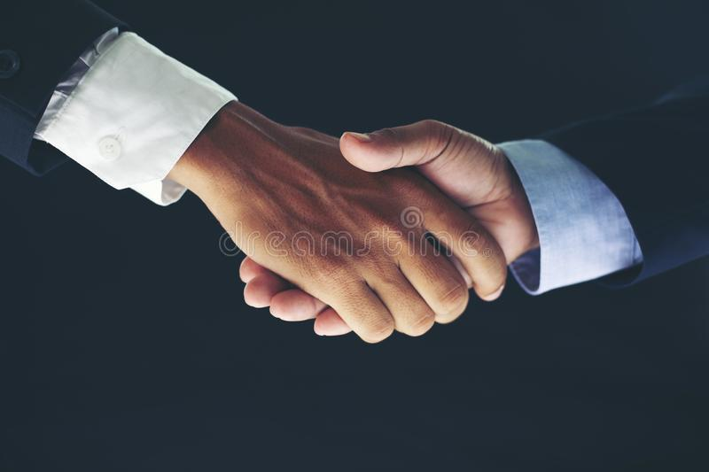 Business partnership meeting concept and business handshake for. Successful of investment deal on black background royalty free stock photo