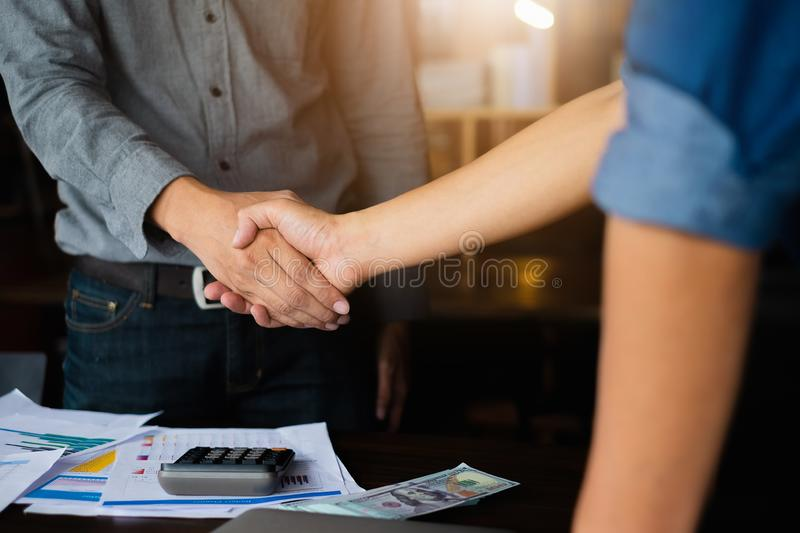 Business partnership meeting concept. Image businessmans handshake. Successful businessmen handshaking after good deal. Group royalty free stock image