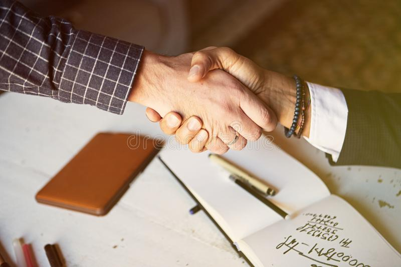 Business partnership meeting concept. Image of businessmans handshake. Successful businessmen handshaking after good. Deal. Horizontal, blurred background royalty free stock photography
