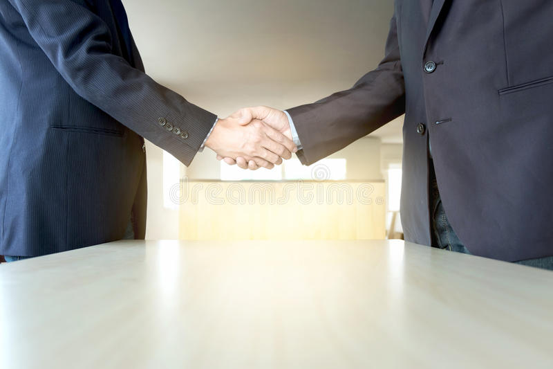 Business partnership meeting concept. Images of business people. Shaking hands while greeting at the working place. businessmen handshaking after good deal royalty free stock photography