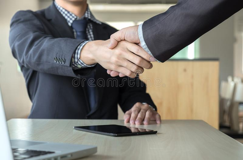 Business partnership meeting concept. Images of business people. Shaking hands while greeting at the working place. businessmen handshaking after good deal royalty free stock images