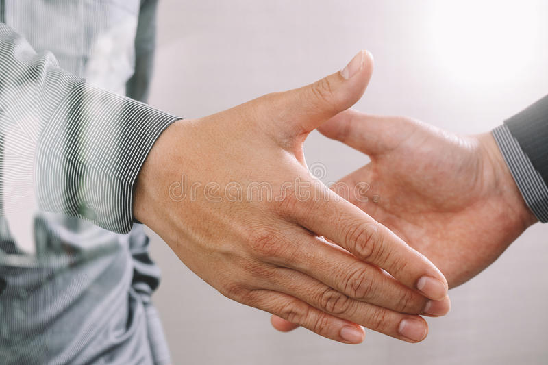 Business partnership meeting concept.photo businessmans handshake. Successful businessmen handshaking after perfect deal.close up royalty free stock photos