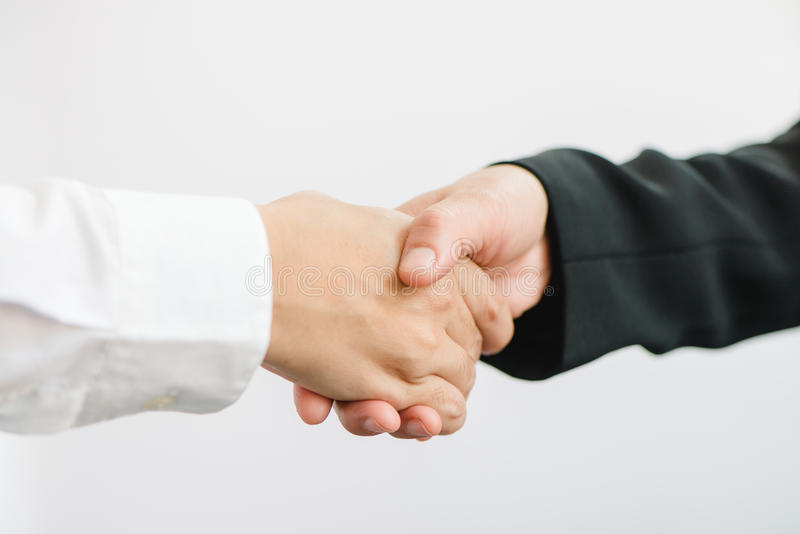 Business partnership meeting. Picture businessmans handshake. Successful businessmen handshaking after good deal. Horizontal, blurred background royalty free stock images
