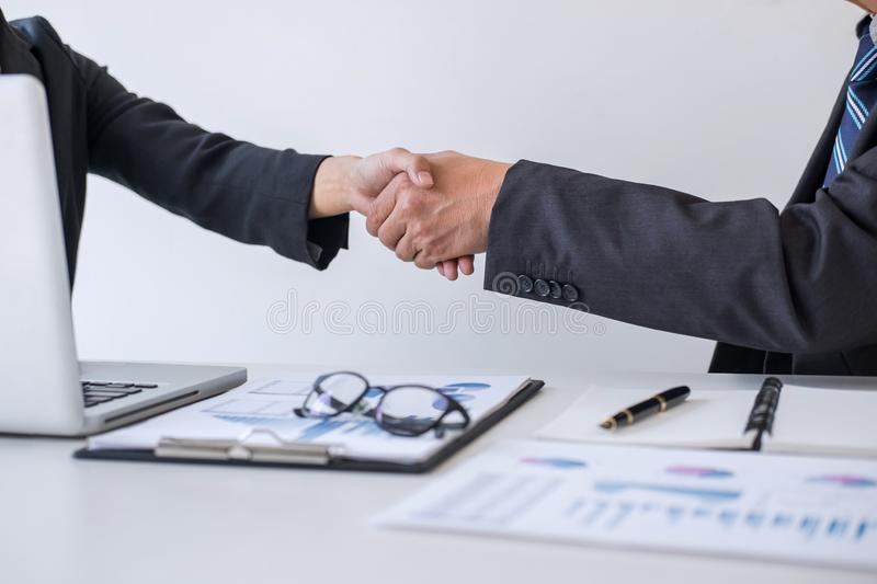 Business partnership meeting, Two confident Business handshake and business people after discussing good deal of Trading contract. And new projects for both royalty free stock photos