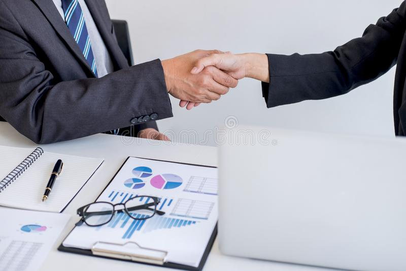 Business partnership meeting, Two confident Business handshake and business people after discussing good deal of Trading contract. And new projects for both stock image