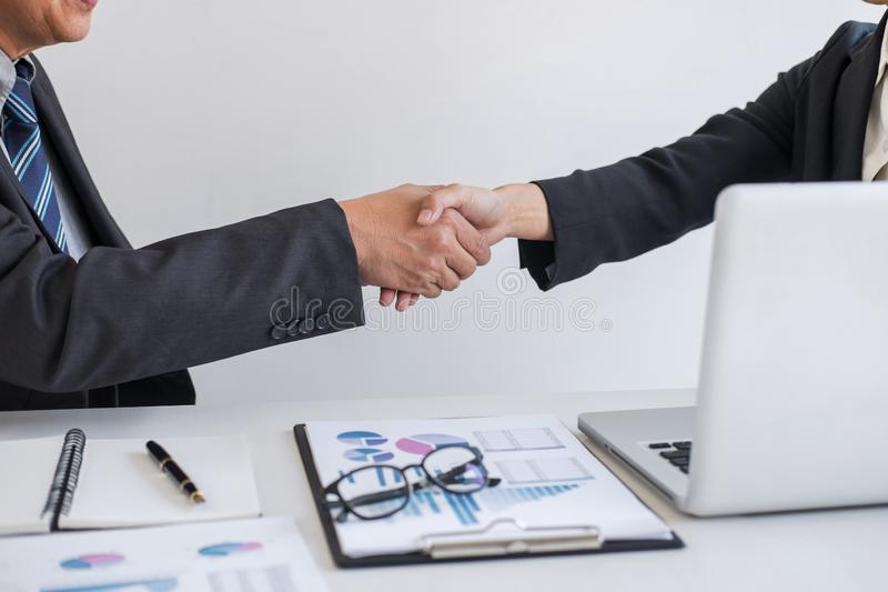 Business partnership meeting, Two confident Business handshake and business people after discussing good deal of Trading contract. And new projects for both royalty free stock image