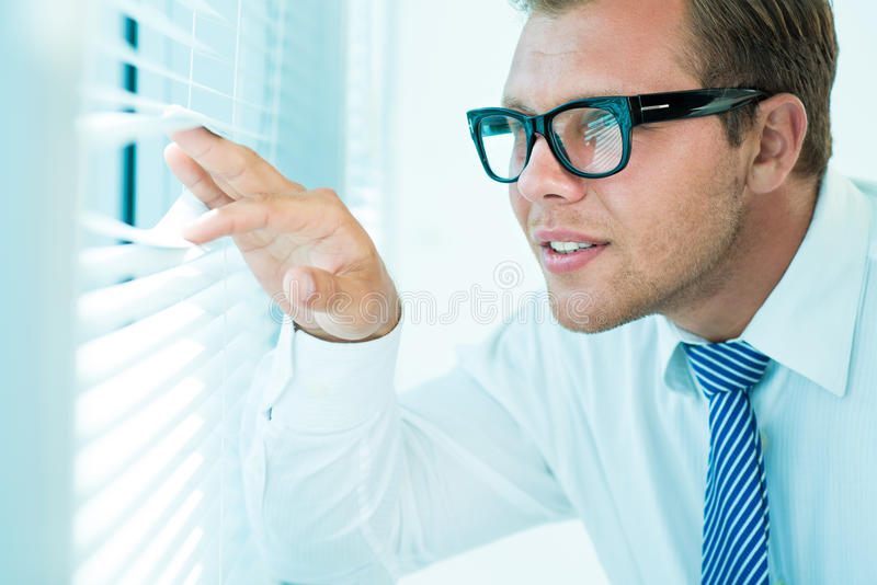 Business peeping royalty free stock photography