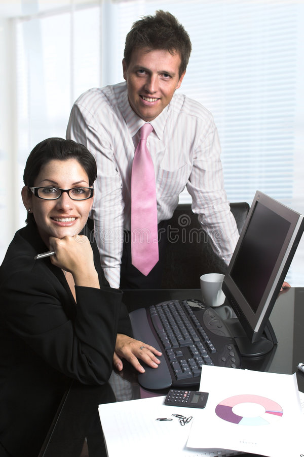 Business people. Young businesspeople are working on computer